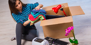 woman unpacking from a big moving box