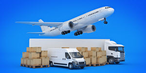 aeroplane taking off, parked trailer, van and moving boxes